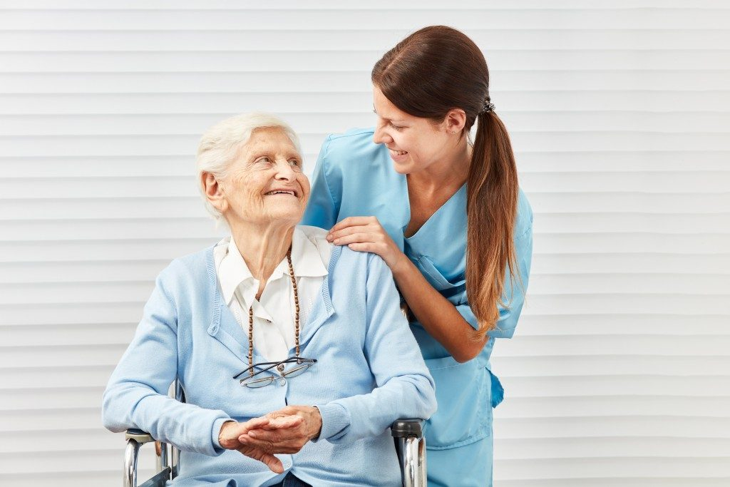 old lady taken care of by a young nurse