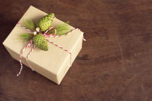handcraft gift boxes gift box with pinecone and pine branch over wooden background