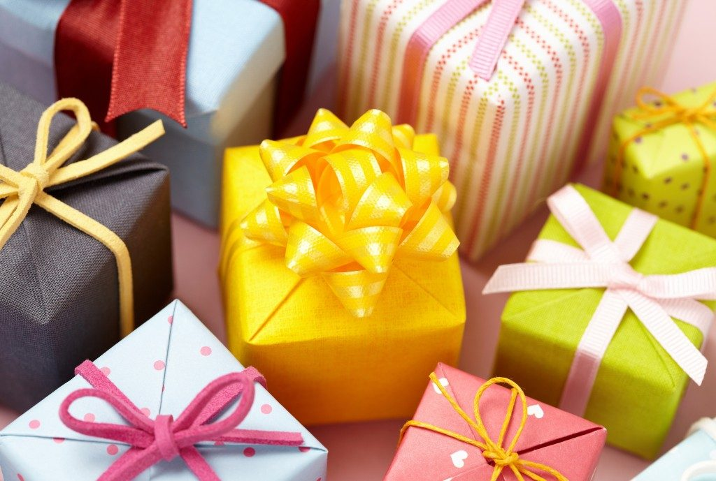 Cute gift boxes on pink background