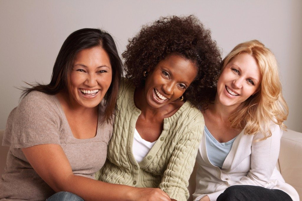 beautiful women smiling together