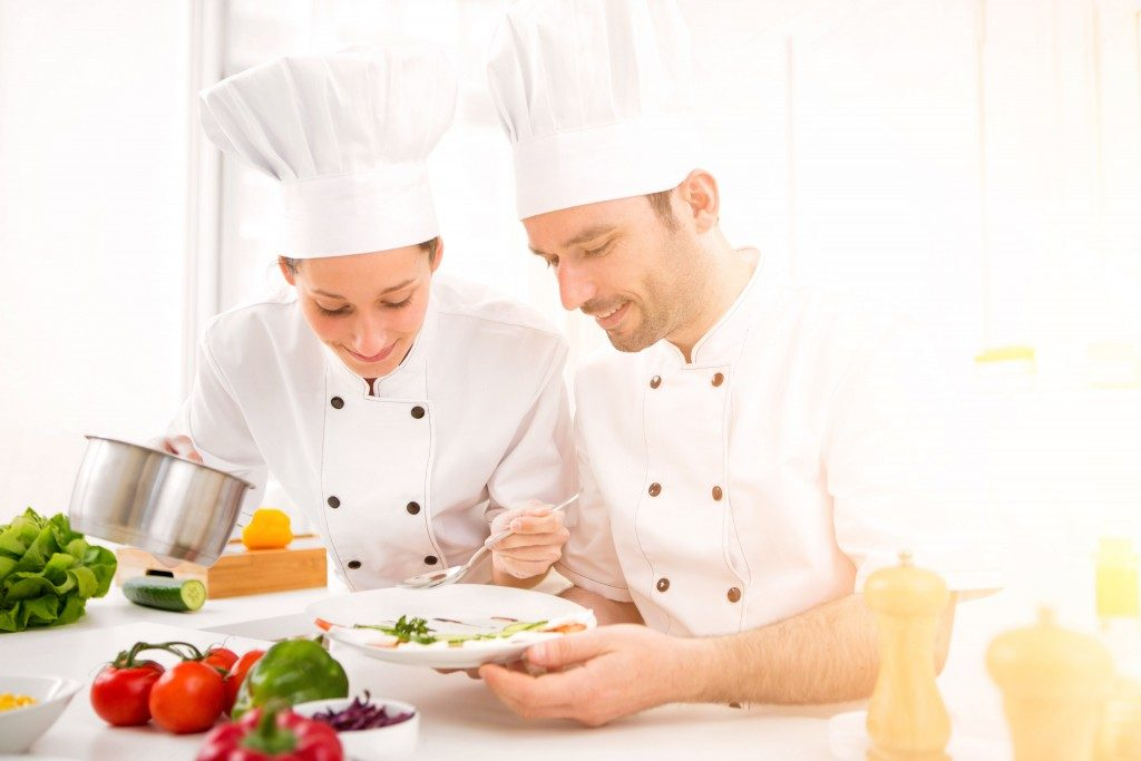 chefs plating a dish
