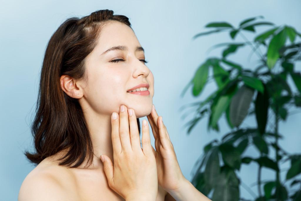 beautiful woman massaging her face