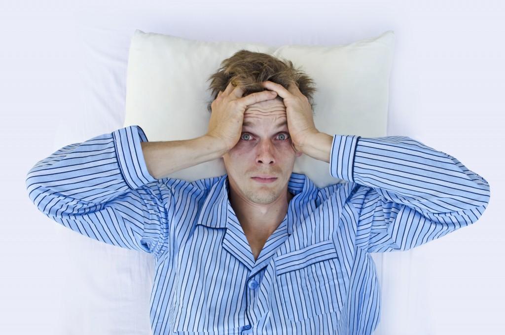 man unable to sleep