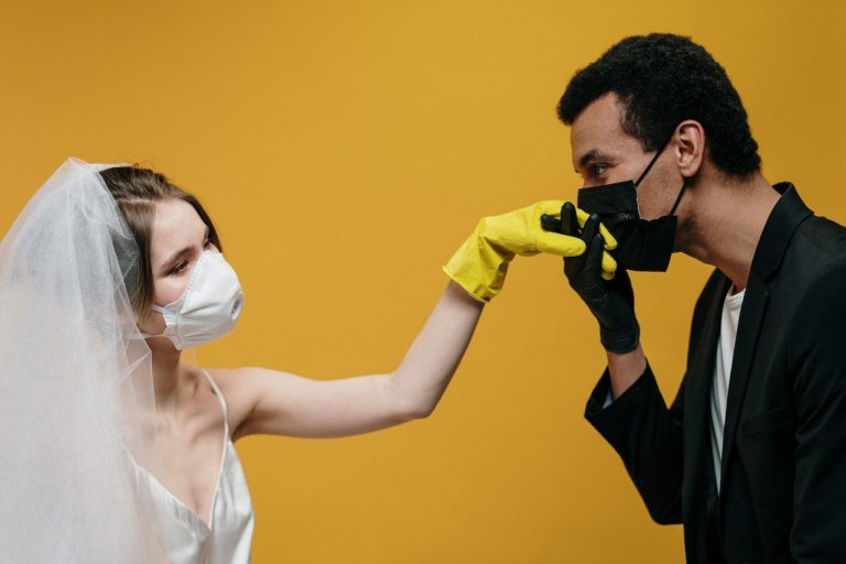 bride and groom wearing masks