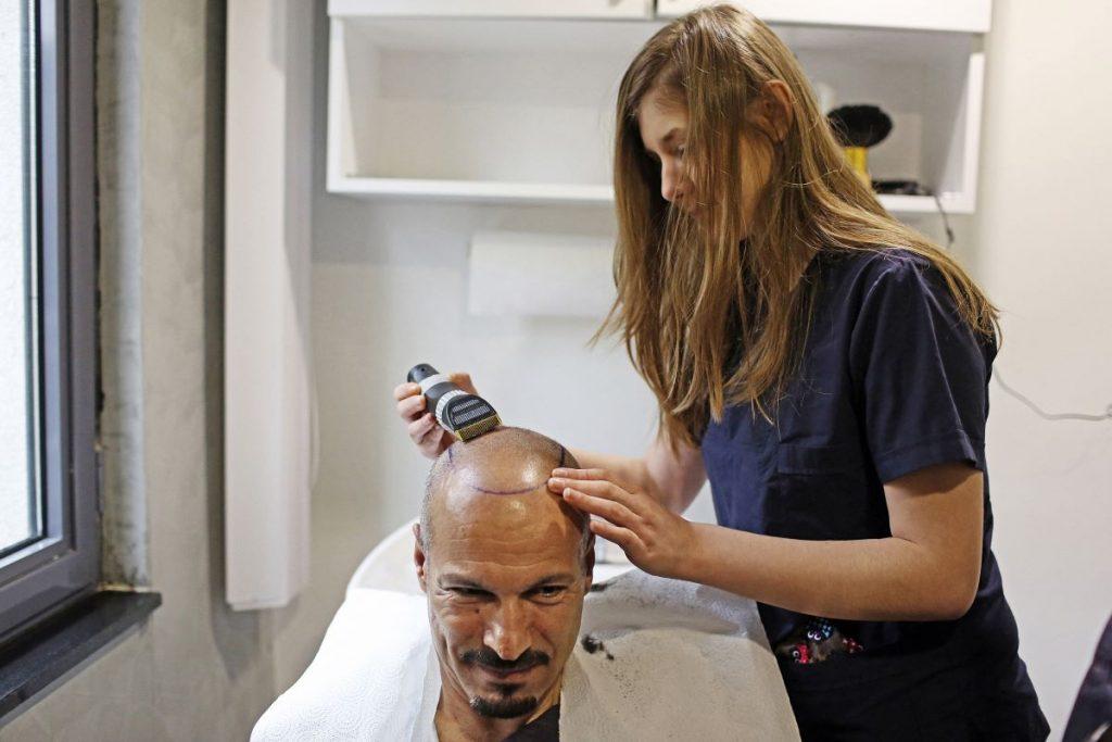 man getting hair transplant