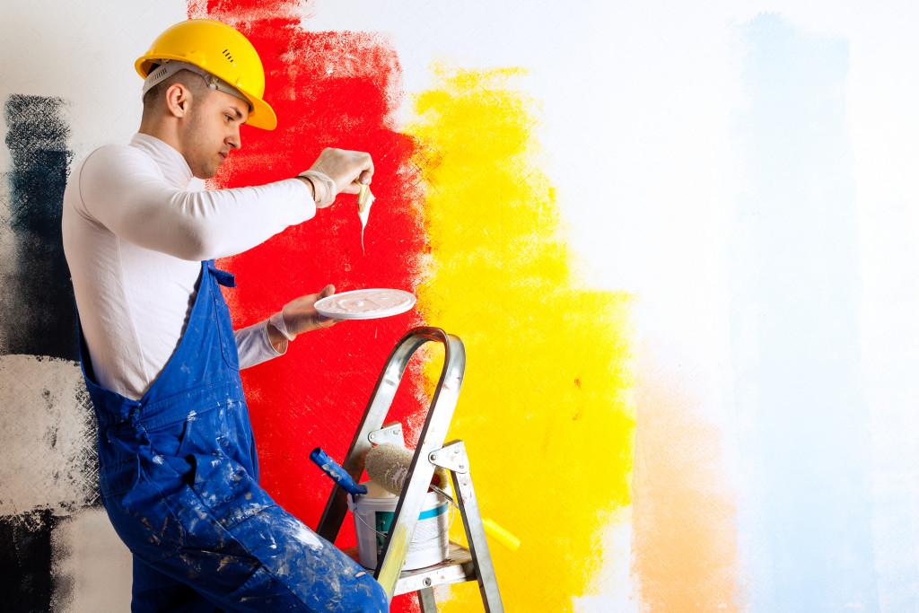 man painting room